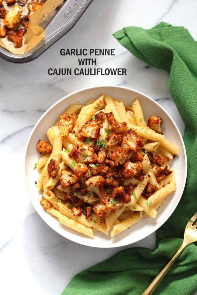 Vegan Garlic Pasta with Roasted Cajun Cauliflower. Cauliflower is tossed in homemade cajun spice blend and baked, then served over easy creamy Garlic sauce Penne Pasta. Vegan Recipe. Can be Nut-free gluten-free | VeganRicha.com