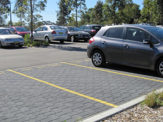 HydroSTON permeable concrete pavers used for parking spaces at Sydney Water Headquarters, Potts Hill NSW, Australia.