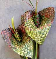Weaving flowers from NZ flax, love the lily look ones.