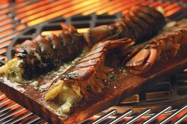 Planked Lobster Tails with Roasted Garlic & Cilantro Compound Butter
