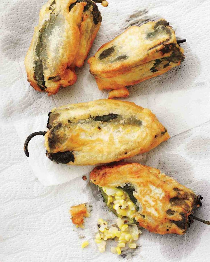 Poblano Chiles Stuffed with Corn and Monterey Jack Cheese - flour - baking powder - coarse salt - lager beer - poblano chiles - Monterey Jack cheese cut into eight 3 in. long sticks - unsalted butter - onion - 2 garlic cloves - corn - freshly ground pepper - safflower oil for frying - lime
