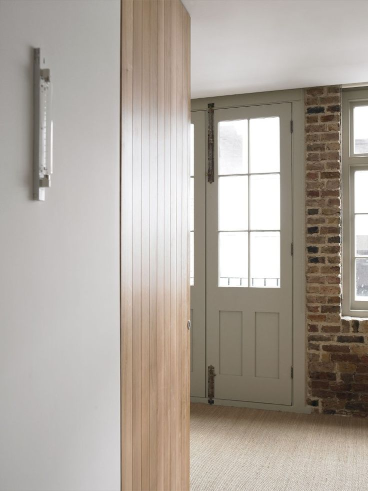 French grey paint exposed brick new oak and seagrass flooring | McLaren.Excell