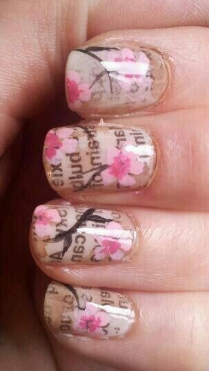 paint your base color ad give it plenty of time to dry then dip a peace of newspaper in to perfume, and lay it on your nail. Then press it on, lift the paper of gently and then let dry. Top coat once dry, then add detail