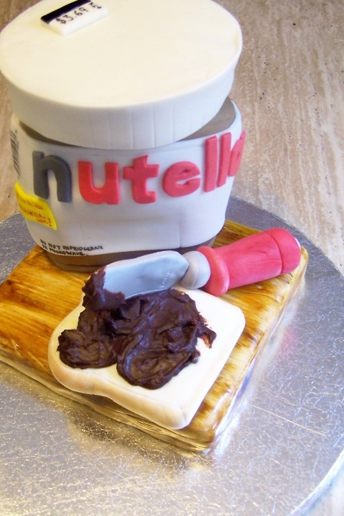 nerdache-cakes:    Not really a nerdy cake, but I do so love me some Nutella. I can eat it in the morning, Lunch, Din-Din. I don't even care.I am a responsible adult who eats chocolate for Dinner.  Done for an 8 year old's Birthday. Huff Huff going back in time to make 8 year old me a birthday cake.