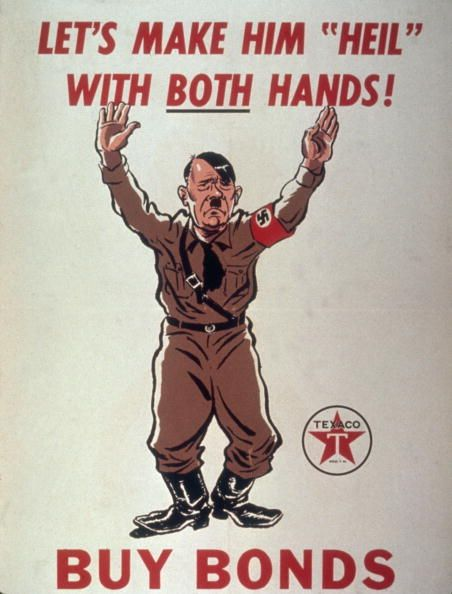 War bonds poster (produced by Texaco) depicts a caricature of German Chancellor Adolf Hilter with his arms raised, as though surrendering, accompanied by the text 'Let's Make Him 'Heil' With Both Hands! Buy Bonds,' early to mid 1940s. (Photo by Hulton Archive/Getty Images)
