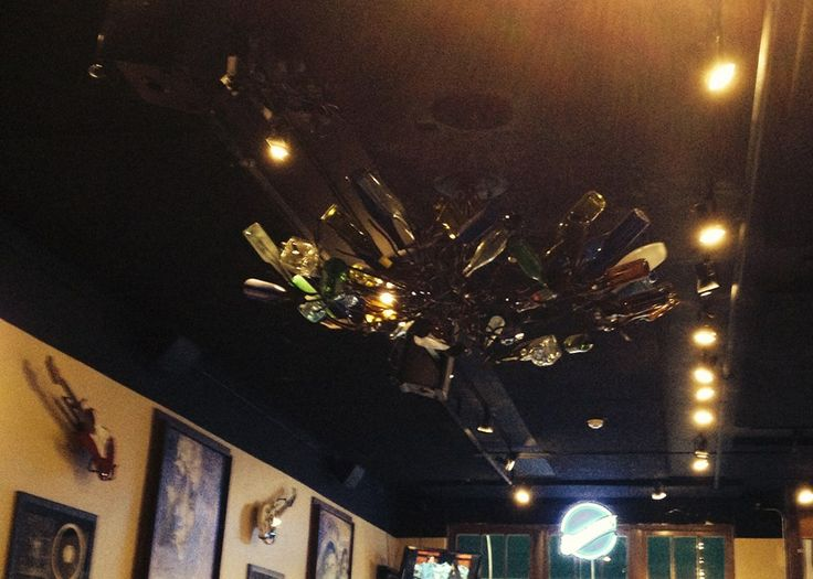 For those of you who want a bottle tree but don't have room in your garden or countertops. Thank you to reader Reeca Elliott for this photo from a restaurant in Oxford, MS!