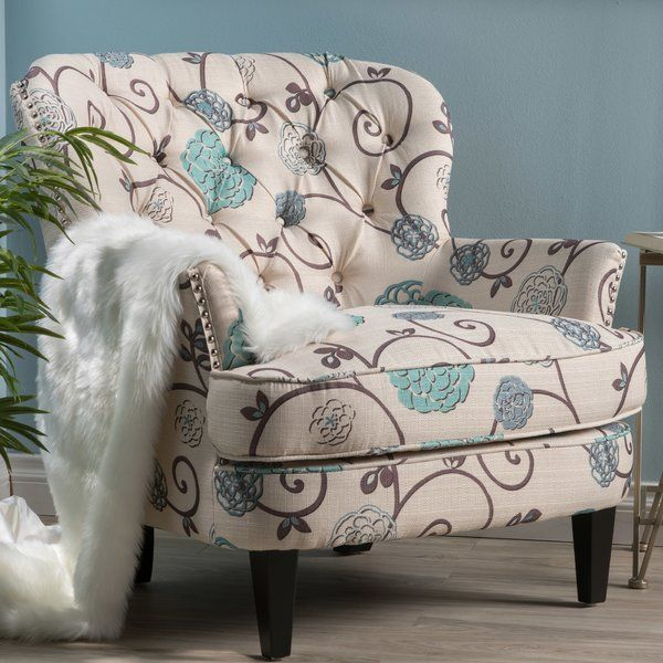 A traditional fanback design gets a contemporary facelift in this charismatic arm chair. Made with a solid birch wood frame, this dapper design features gently flared arms, handsome nailhead trim, and stain-resistant polyester blend upholstery in a swirling scrollwork and floral motif. For a timeless ensemble in your open concept living space, roll out a colorful medallion-print area rug to define the space, then arrange a button-tufted chesterfield sofa and this charming chair around a…