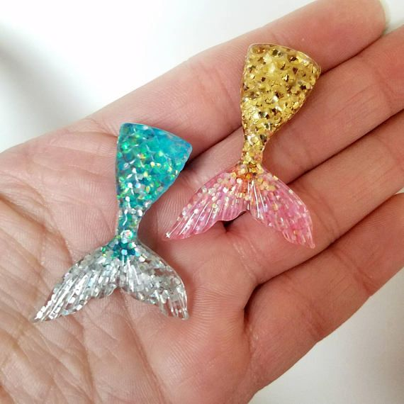 Resin FAKE mermaid tail is perfect for all sorts of projects! Use these colorful cabochons to decorate cell phone cases, compacts, hair accessories, or attach an eye screw to make charms and incorporate into your jewelry designs! Button comes with shank back. Can be easily