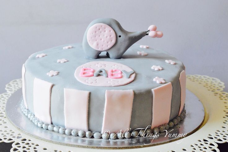 Baby Shower Cakes - Grey Elephant Baby Shower Cake with WHite and Grey Stripes Fondant Decor and a Fondant Baby Elephant | All Things Yummy #allthingsyummy #babyshower #fondant #elephant #baby #cakes