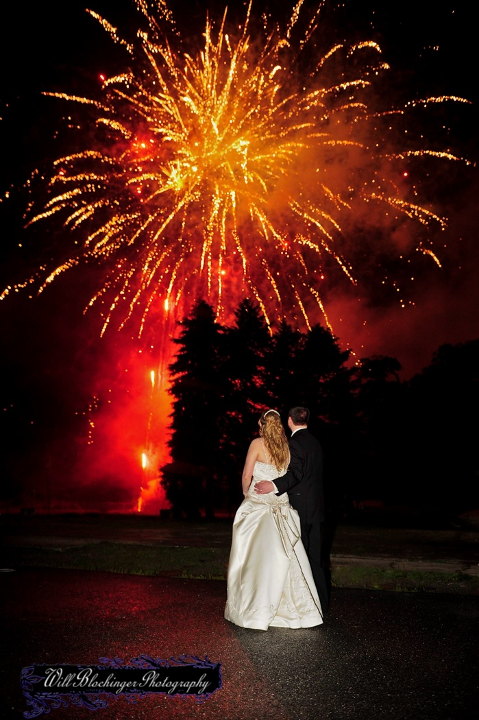 beach wedding in new jersey%0A bride and groom watching the fireworks go off during their wedding at  Perona Farms  Nj