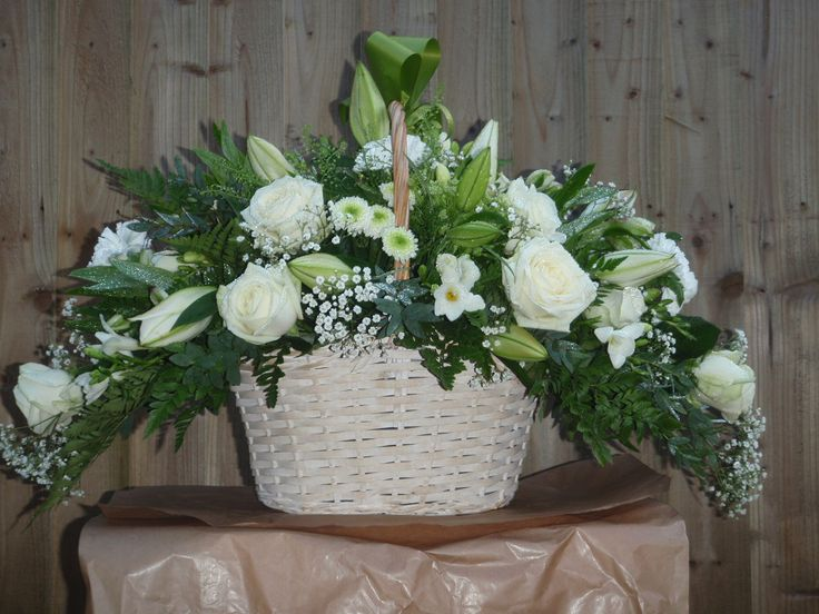 Beautiful all white sympathy basket arrangement