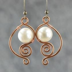 "Pretty spiral design wire earrings with ""pearls"""