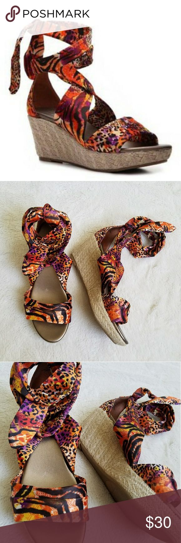 "🆕IMPO Satin Tie Up Animal Print Espadrille Wedges EUC pair of IMPO orange and purple animal print Espadrille wedges. Straps are satin. The heel measures 3 3/4"". The heel of the right shoe has some discoloration, as shown in last photo, but it's not too noticeable. These shoes have been worn once! Shoes Wedges"