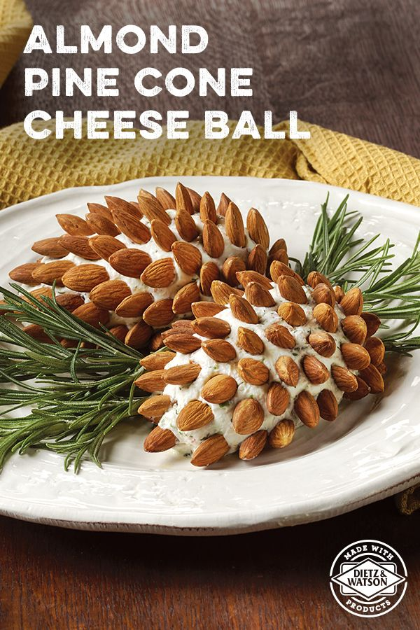 This Almond Pine Cone Cheese Ball, made with a creamy mix of Dietz & Watson Goat Cheese and Bacon, is a festive appetizer for your Holiday party.