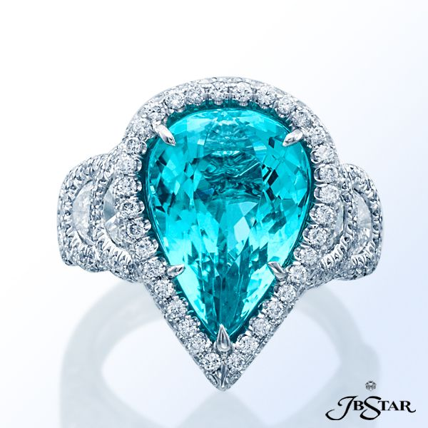 Style 2129 Platinum diamond ring featuring an exquisite 7.90ct pear-shaped paraiba embraced by six individually matched half moon diamonds and edged in micro pave.