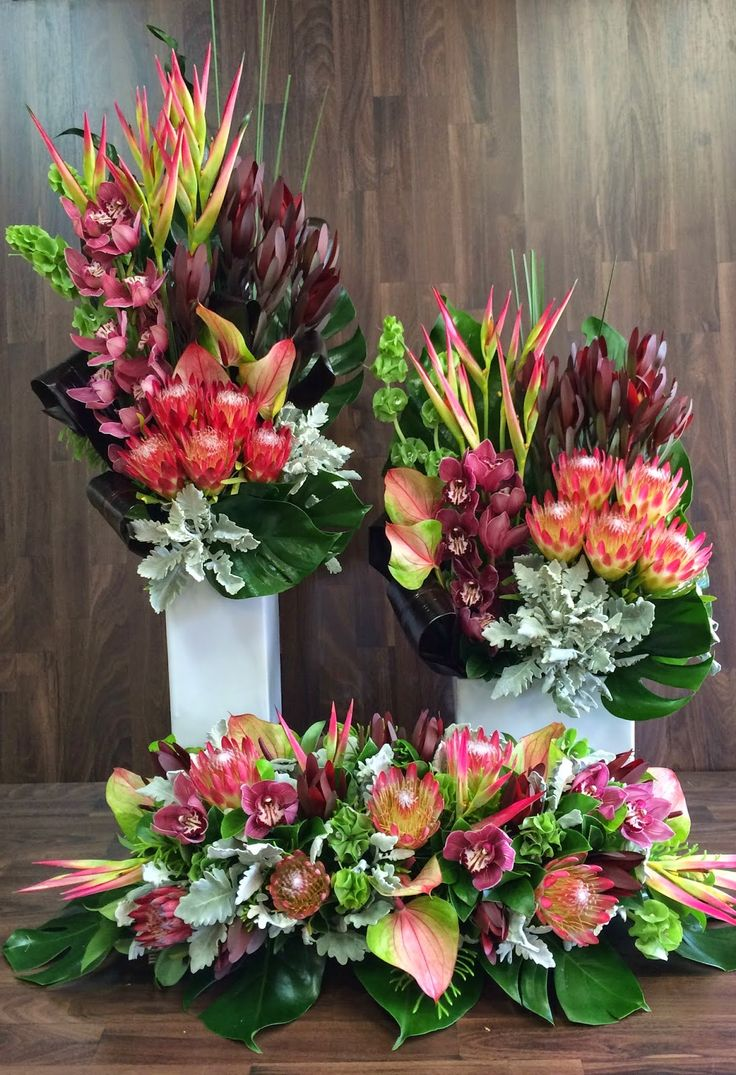 Australian Native Flower Arrangements For Church Event -  Pink Ice Proteas, Repen Proteas, Tetra Nuts, Baxteri Banksia, Menzisii Banksia, Green Nutty Leaucadendron, Red Leaucadendron, After Dark Foliage, Dusty Miller Wax Flower
