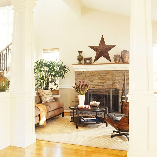 Like the casualness of this fireplace also has a nice contrast  to the walls