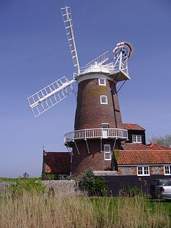 "Cley Windmill is a tower mill at Cley next the Sea, Norfolk, England which has been converted to residential accommodation. It was built in the early 19th century. The first mention was an advert in the Norfolk Chronicle  1819, where the mill was for sale, described as ""newly erected"" & in the ownership of the Farthing family. The mill was not sold and remained the property of the Farthing family, until 1875"