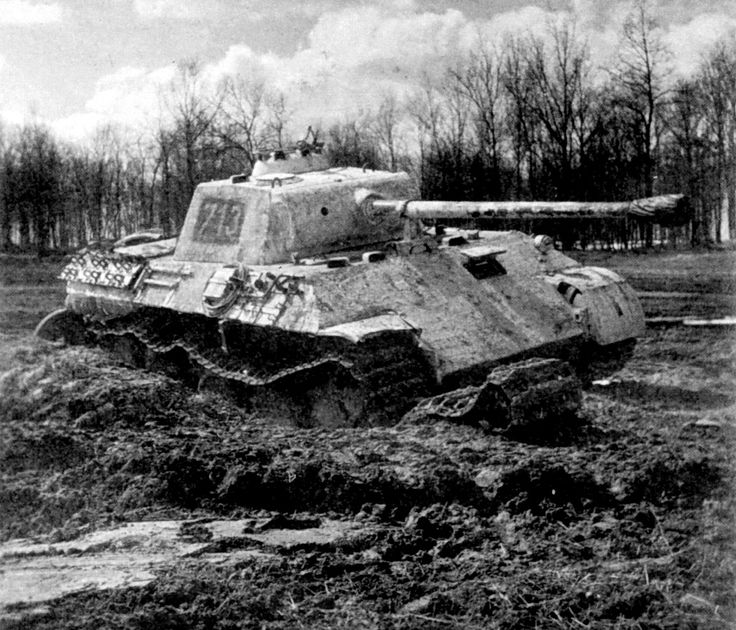 "A damaged PzKpfw V Ausf. D Panther"" medium tank (tactical number 713 "") of the IInd Battalion, 5th SS-Panzer Regiment, 5th SS-Panzer Division Wiking"" rests by a dirt-track."