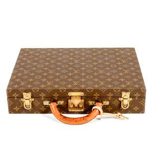 LOT:1156 | LOUIS VUITTON - a monogram Rigid briefcase.