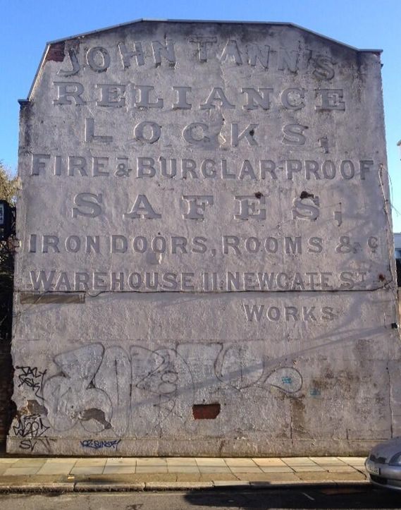 When a ghost sign comes back to life / Photograph by Crispin Finn