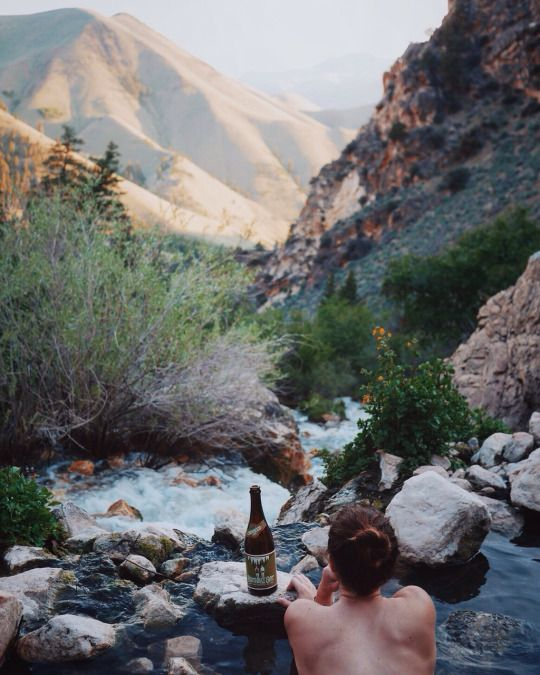 topless in a mountain stream with a view and a beer...please