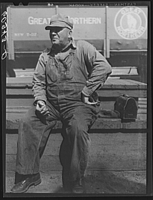 A railroad worker in Minneapolis, MN takes a lunch break. Unknown date.