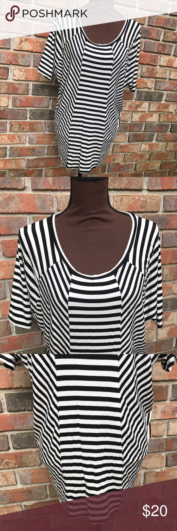 Multi Diagonal Striped Black & White Batwing Top Lightly Used | Excellent Condition | Black & White Colors | Multi Diagonal Stripes | Batwing Sleeves | Short Sleeves | Lightweight | Length: 17.5ins | Bust: 48ins | Sleeve Length: 13.5ins | 96% Rayon | 4% Spandex | Kenneth Cole Tops Blouses