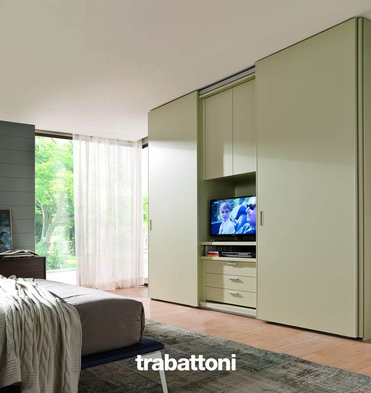 TV unit in the bedroom which can be hidden by wardrobe sliding door, here in hemp lacquer.