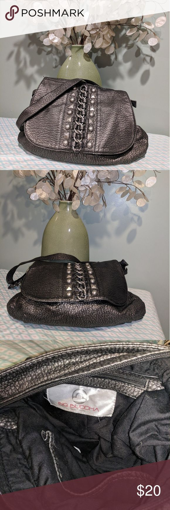 Big Buddha handbag This handbag is in good used condition. Beautiful metal work on the front and strap. Magnetic buttons and can also be zipped shut. Big Buddha Bags Shoulder Bags