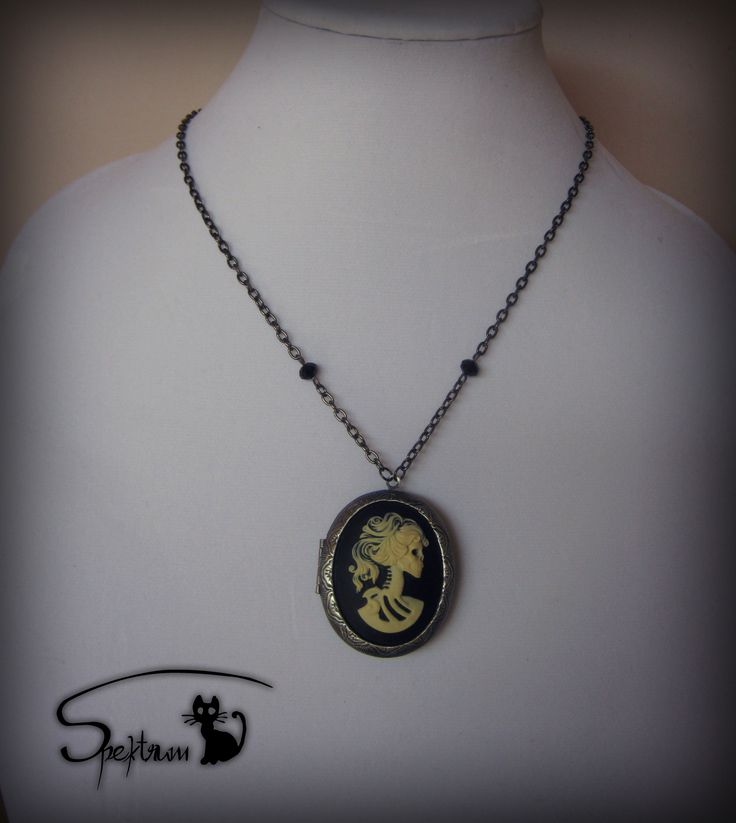 Locket with skeleton lady cameo