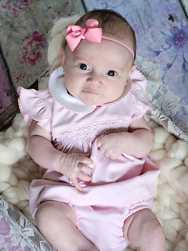 Luxury baby girls pink dress and bloomers made in 100% pima cotton, white scalloped peter pan collar, the angel wing sleeves are also scalloped and hand smocking across the chest. A touch of luxury fo