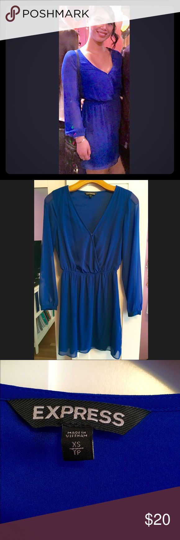 Blue long sleeve flowy dress Blue long sleeve flowy dress from Express. Classy and chic with a bold blue color. Dress has semi sheer sleeves, fitted waist, and flowy skirt. There is a clasp in the front if you want a more opened look. Express Dresses Long Sleeve