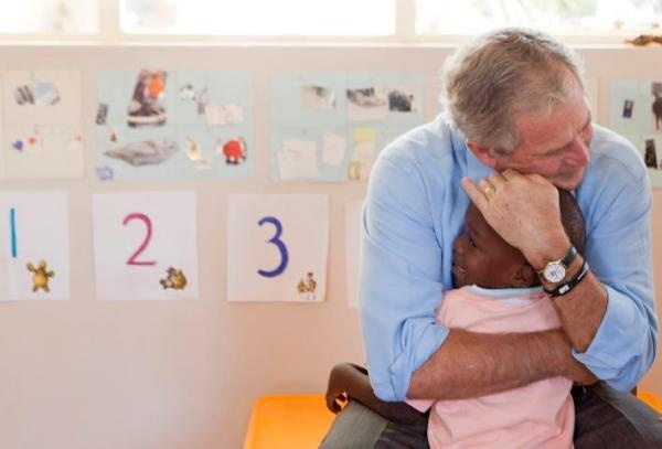 President George W. Bush hugging an orphaned child in Kasisi Children's Home in Lusaka, Zambia.