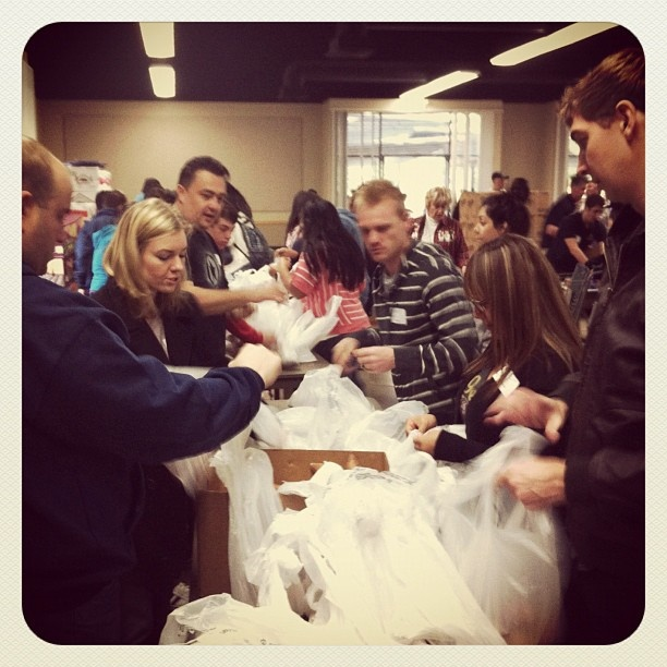 Our holiday give-back initiative!  Packing 18,000 Xmas gifts for families #the1stmovement