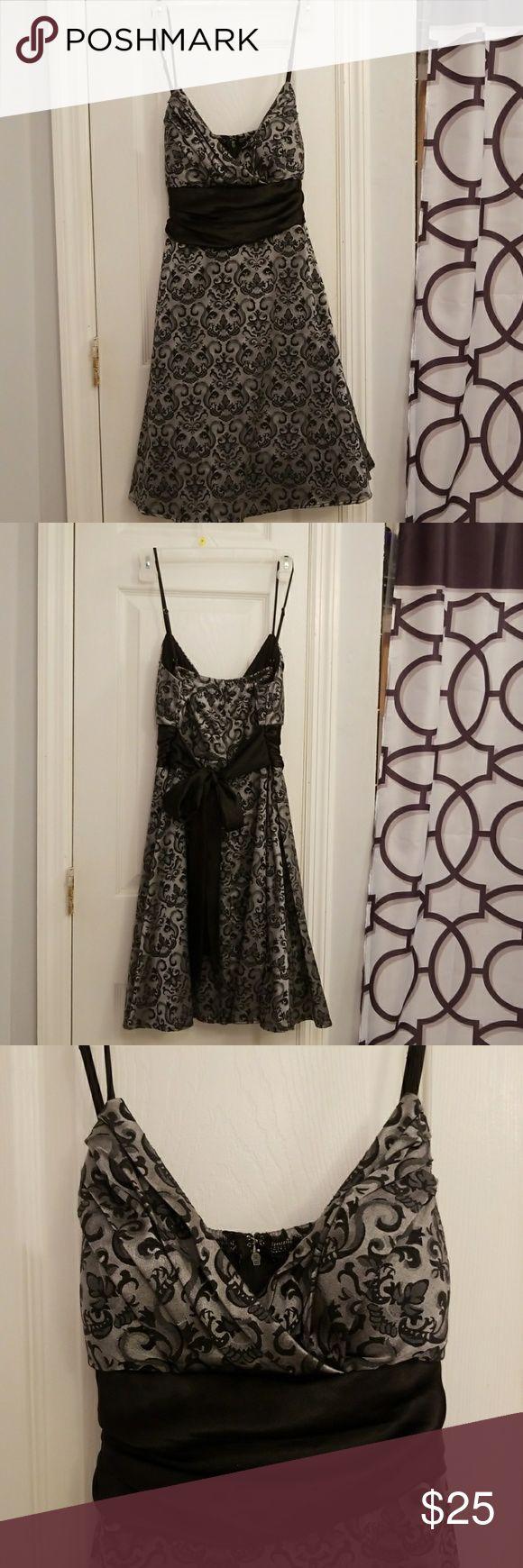 Black and silver dress Black and silver dress. Small amount of tule. worn once Speechless Dresses Midi