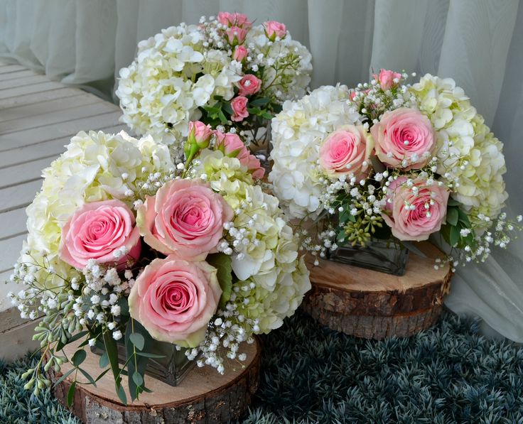 Pink rose and white hydrangea centerpieces reception
