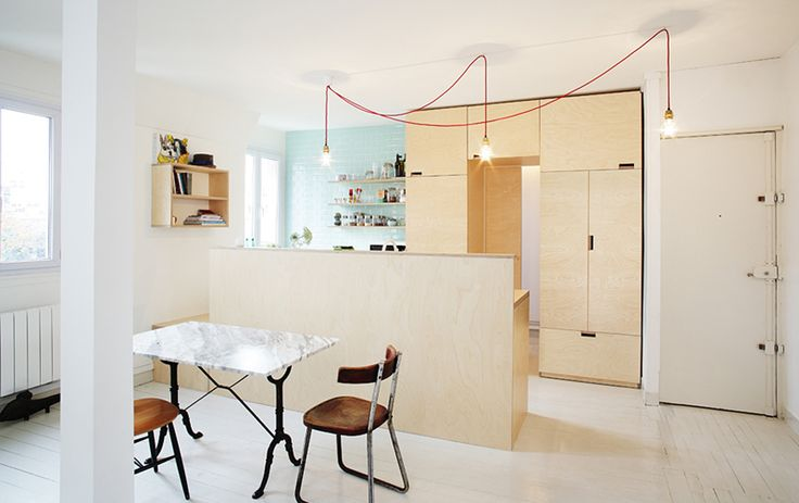 Septembre Architecture // Blank // Renovation of a 70m² apartment for a family of four in the 19th district of Paris. Project delivered in july 2011. Removing the partition walls created a larger living area, with an open plywood kitchen becoming the main feature of the space. Project delivered in July 2011.