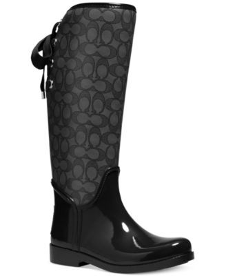 COACH Tristee Rainboots $103.60 Pretty ribbons lace up the back of this lightweight rubber rainboot. Finished with precise stitching and contrast leather trim, its equestrian-inspired design is made to withstand all manner of inclement weather.