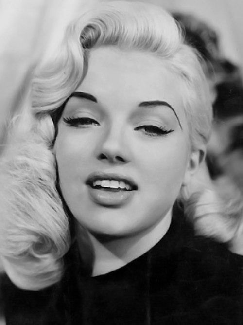 Diana Dors' glamorous curls and delicate winged liner...