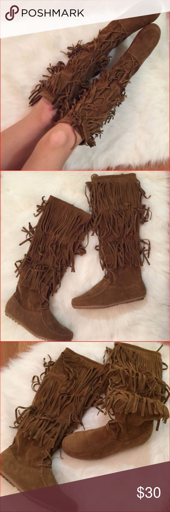"""Calf High 3 Layer Fringe w Laces Moccasin Boots Keep your casual look on trend this season in these suede boots. Western inspired fringe details, add a boho flair to your laid back style!  Features include front laces, 3 layers of fringe, round toes, flexible rubber soles and side zipper. Outstanding boots for festivals, concerts, and just because you will look amazing in them!  11"""" shaft height. Calf width can be adjusted with laces from 11"""" to 15"""" Cognac dyed suede. Previously loved and…"""