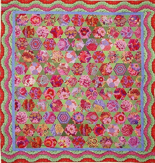 Red Mediterranean Hexagons Quilt from Quilts in Morocco by Kaffe Fassett.  Kit at Glorious Color.