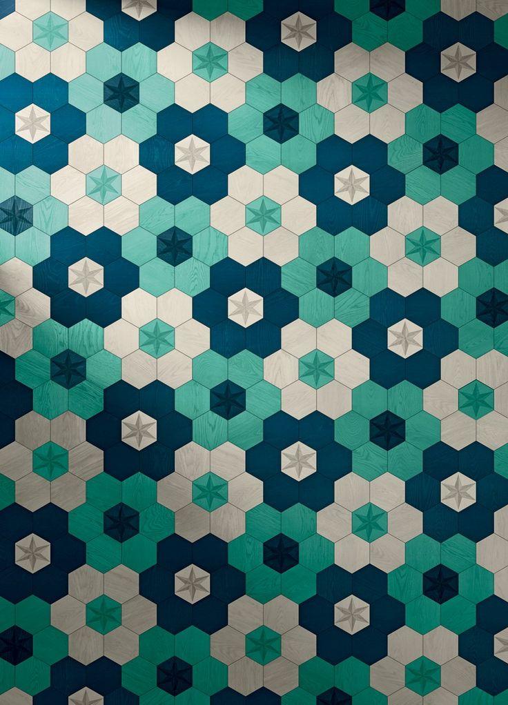 for italian brand bisazza's wood collection, dutch designer edward van vliet designs a colorful parquet series of laser-engraved hexagonal patterns.