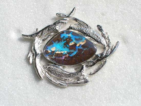 Sterling silver brooch with boulder opal. Designer by Ailin Roelvaag, inspired by the Dreamtime stories.