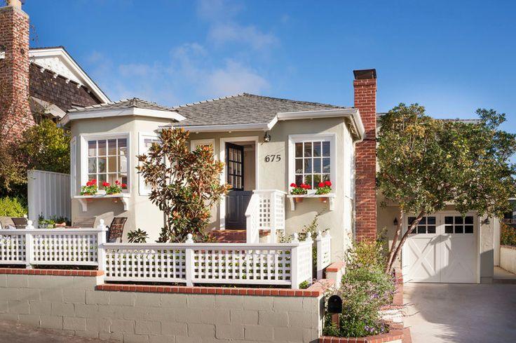 Cottage: eggshell paint, white lattice fence, black door, brick chimney