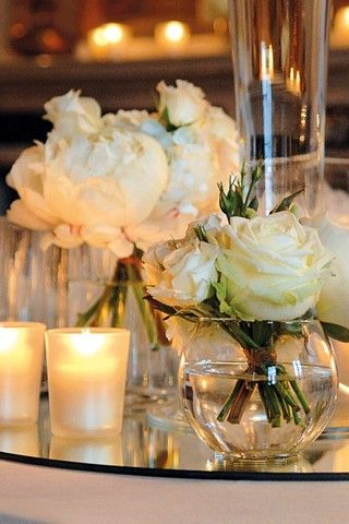 Tea lights and white flowers add a clean and romantic look.