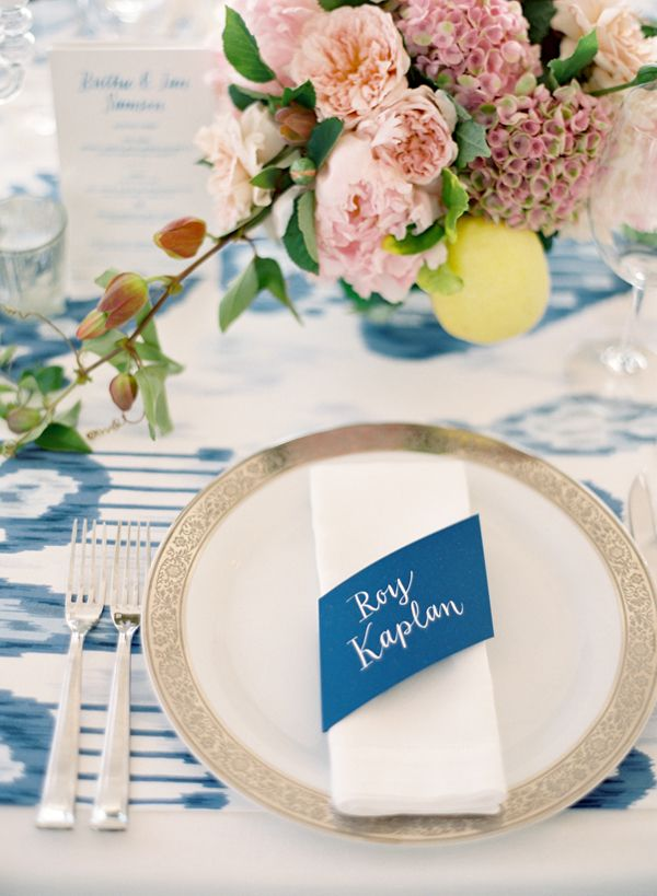 Gorgeous and unique (almost china pattern) blue print table linen and blue paper napkin ring place card.