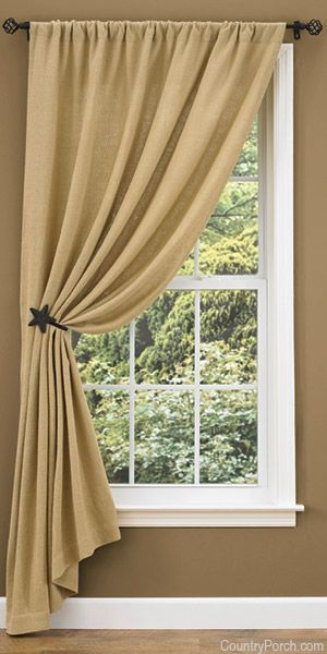 One of our most popular window treatments this year is the Burlap Unlined Single Tieback Curtain Panel shown with the black star curtain hook. CountryPorch.com
