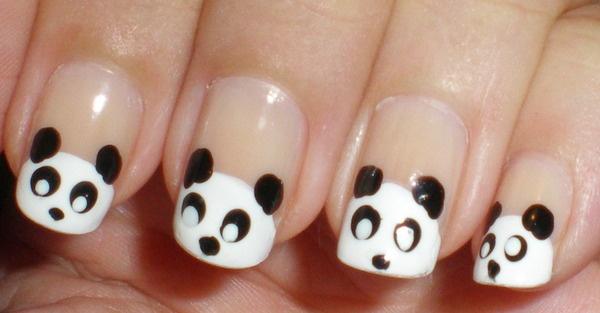 OMG! Panda nails!  Video tutorial here: http://www.youtube.com/watch?feature=player_embedded&v=1mYnXQbAq-I