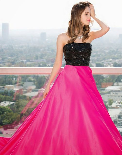We love this pink and black prom dress being modeled by Laura Marano